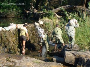 JR and the scouts fixing the weir